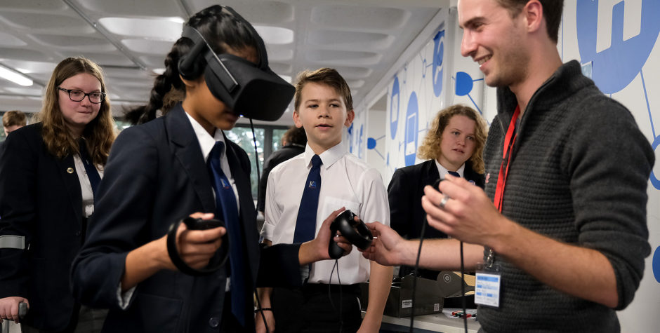 Marcus Taylor with students trying out at virtual reality at King Alfred's Academy