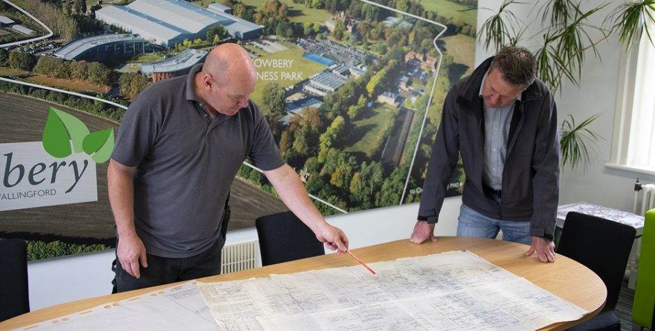 Paul and Rob inspecting the 1951 and 1967 drawings