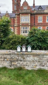 Bird boxes on wall at Howbery ready to go out in the grounds
